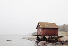 Red Fisherman Hut In Fog