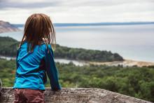 Young Girl Overlooking A Lake