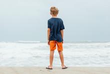 Boy On The Beach As A Hurrican...