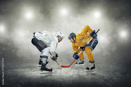 Ice hockey player on the ice, outdoors Canvas Print