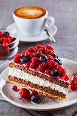Fototapeta Do herbaciarni Piece of fruit cake with cup of coffee