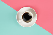 A Cup Of Black Coffee On Blue And Pink Background. View From Above.