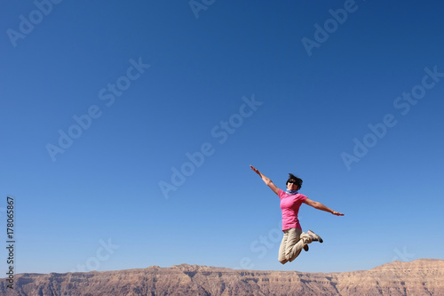 One woman jump for joy  - Buy this stock photo and explore