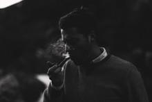 Young Man Smoking Pipe
