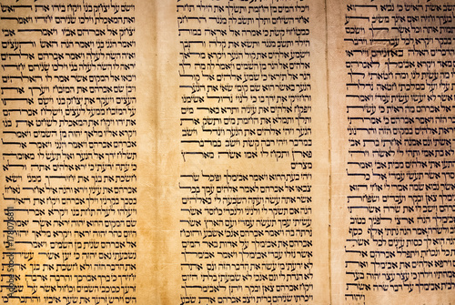Photo A Sefer Torah or Torah scroll is a handwritten copy of the Torah, the holiest book in Judaism