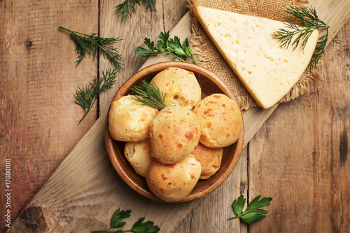 Tuinposter Brood Homemade cheese buns, rustic style, vintage wooden background, top view