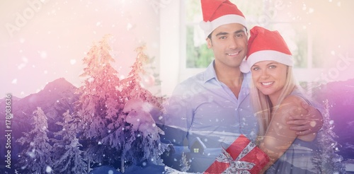 Spoed Foto op Canvas Wit Composite image of happy couple at christmas
