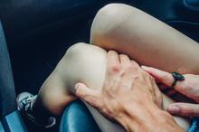 Man Having His Hand On Woman's Leg