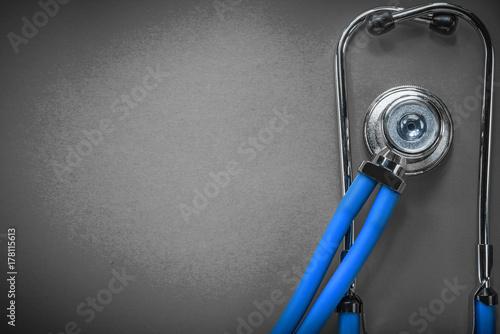 Fototapeta Medical auscultator on green background medicine concept obraz na płótnie