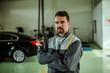 Portrait of a car mechanic in his shop.