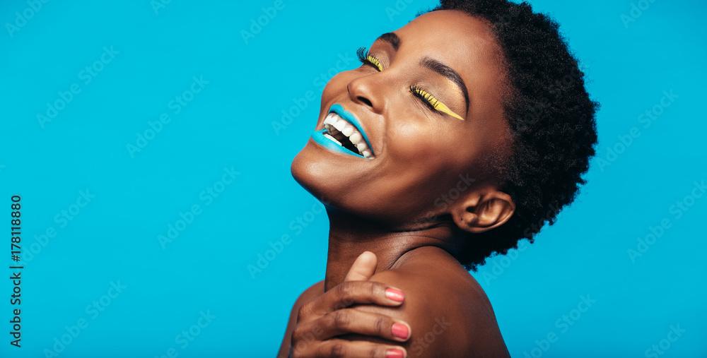 Fototapeta Beauty portrait of woman with colorful makeup
