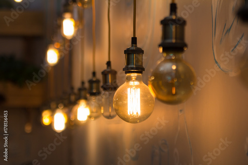 vintage style light bulbs in interior of restaurant buy this stock