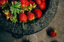 Fresh Strawberries In A Granite Mortar