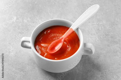 Canvas Prints Tea Ceramic bowl with baby food on grey background