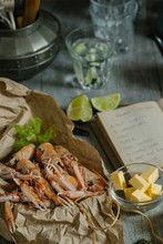 Langoustines On Kitchen Table With Recipe Book.