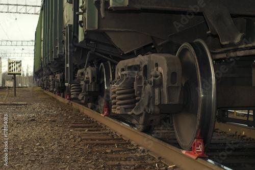 A bogie of freight railcar closeup, with brake shoe put under the wheel Wallpaper Mural