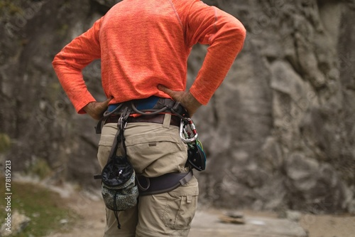 Man wearing safety equipment during mountaineering