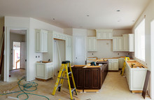 Custom Kitchen Cabinets In Various Stages Of Installation Base For Island In Center