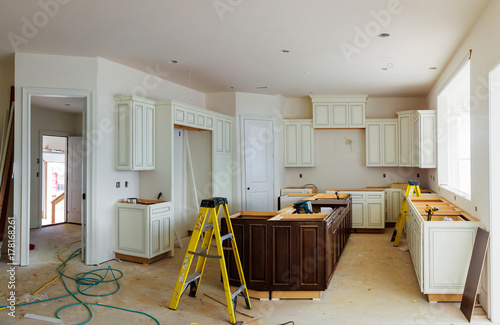 Fotografia  Custom kitchen cabinets in various stages of installation base for island in cen