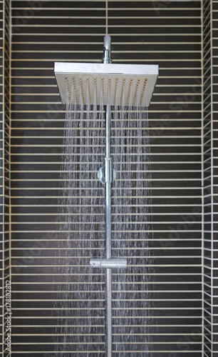 Head shower while running water.