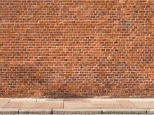 Red Brick Wall With Sidewalk