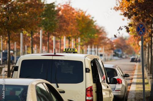 Fotografie, Obraz  Taxi cars on the city street
