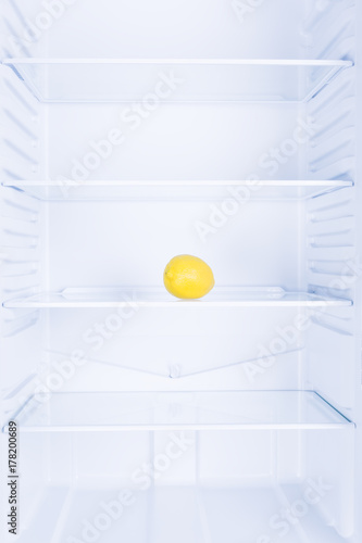 Lemon in empty clean refrigerator, inside