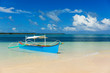 Traditional fishing boat on pristine beach