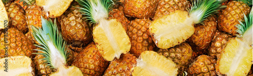more then one pineapple with some cut in half Canvas Print