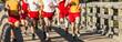 High school boys cross country race going over a bridge