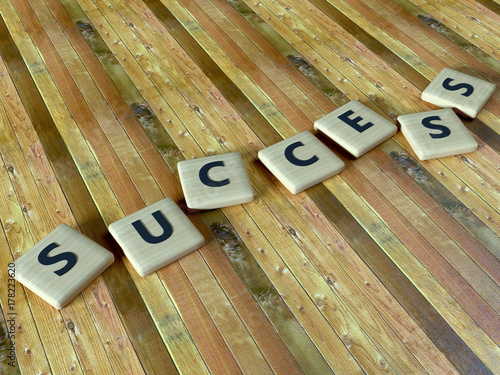 Fotografia, Obraz  Success - wooden scrabbles on a table - word - 3d render
