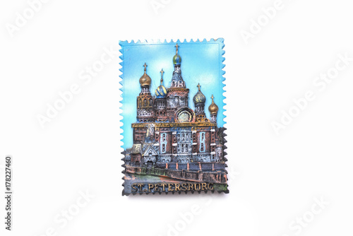 Photo  Magnet on the refrigerator from St. Petersburg isolated on white