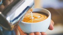 Barista Pouring Streamed Milk To Make Heart Shape Latte Art In Cup Of Hot Coffee, Retro Tone