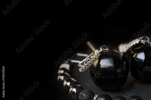 Fotografie, Obraz  jewel  bracelet with semipreciouse stones and earrings with black  semiprecious