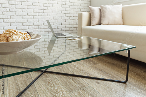 modern glass table in the loft interior
