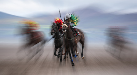 Galloping horse race on the beach, motion blur effect