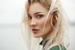 Leinwanddruck Bild - Profile of stunning blonde with deep hazel eyes