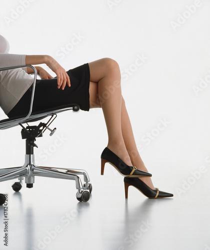 Damenbeine In Einem Klassischen Buerostuhl Buy This Stock