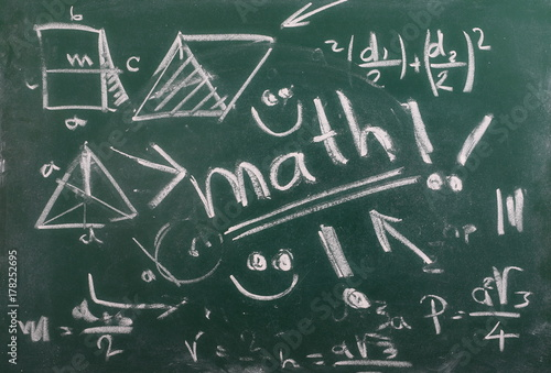 Mathematical equation on chalkboard, blackboard texture