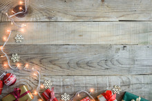 Christmas Presents On Wooden Table Top Background