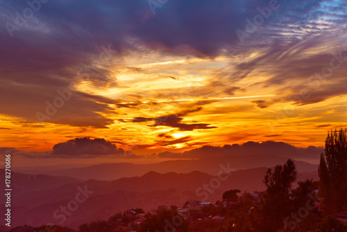 Tuinposter Bordeaux Amazing mountain landscape with colorful vivid sunset on the bright sky, natural outdoor travel background
