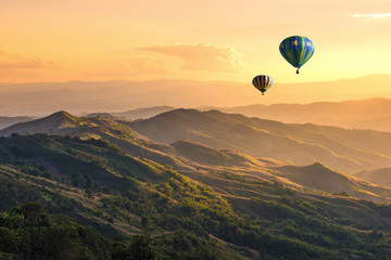 FototapetaHot balloon air over doi Chang at sunset ,Chiang Rai, Thailand.