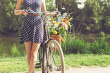 Woman With Old-Fashioned Bicyc...