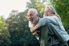 Happy Senior Couple Smiling Outdoors In Nature