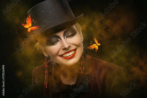 Valokuva  Girl in hat with bright make-up on Halloween in the studio
