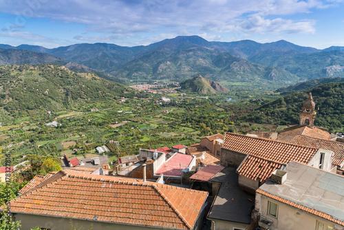 Fényképezés  View across the roof tops of Castiglione di Sicilia, Sicily, Italy towards Franc