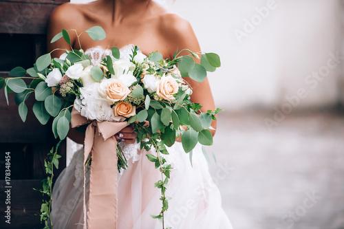 beautiful bride in a luxurious dress in eco-style Fototapeta