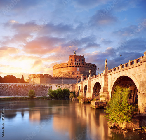 Photo  Saint Angelo Castle and bridge over the Tiber river in Rome
