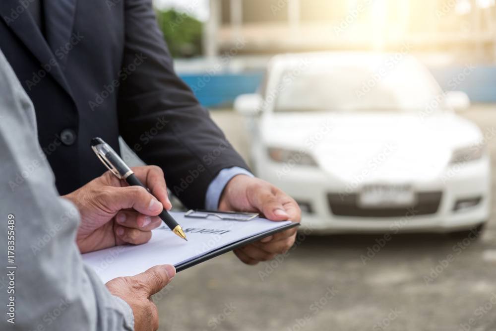 Fototapety, obrazy: Insurance Agent examine Damaged Car and customer filing signature on Report Claim Form process after accident, Traffic Accident and insurance concept