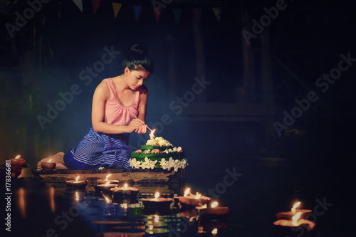 Fotografie, Obraz  Loy Krathong Traditional Festival, Thai woman hold kratong, Thailand, Asia woman in Thai dress traditional hold kratong and bring Krathong to float in Loi kratong day of Thailand